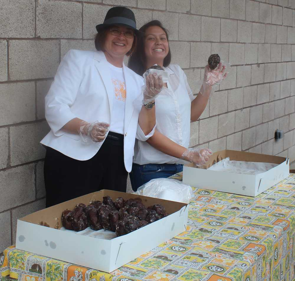 Student Council adviser, Toni Normand, and spirit head, Jaclyn Sakamoto, distributed poi doughnuts to students during Spirit Week.