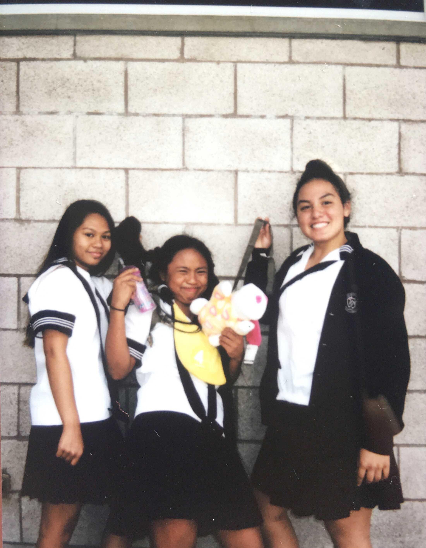 "Juniors Rochell Agapay and Hi'ialo Apo with their freshman ""little sister,"" Mickayla Baniaga, for Mini Monday."