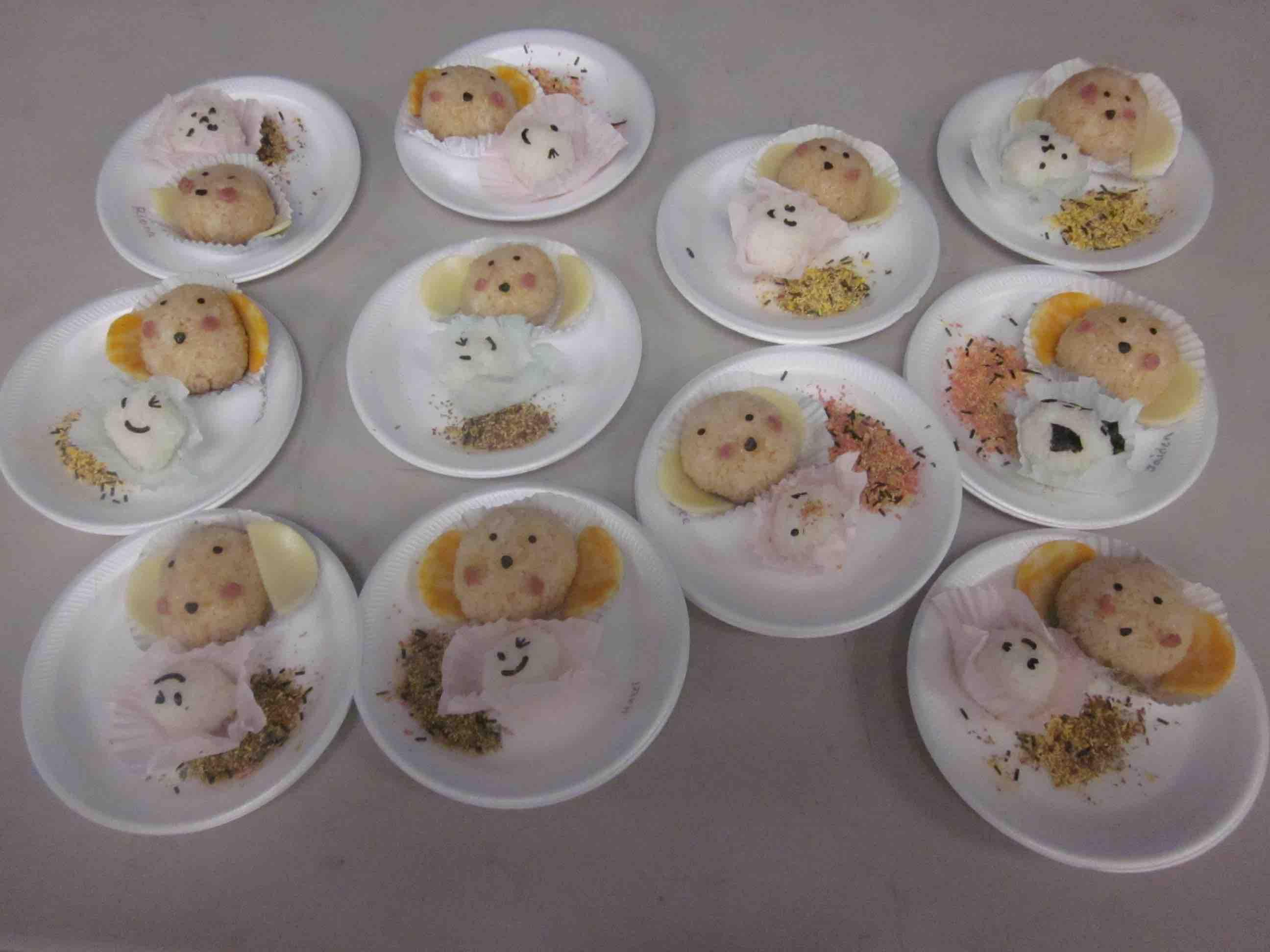 A presentation of onigiri, or rice balls. Japanese language students taught lower school students more about the culture. Photo credit: Nami Grafia.