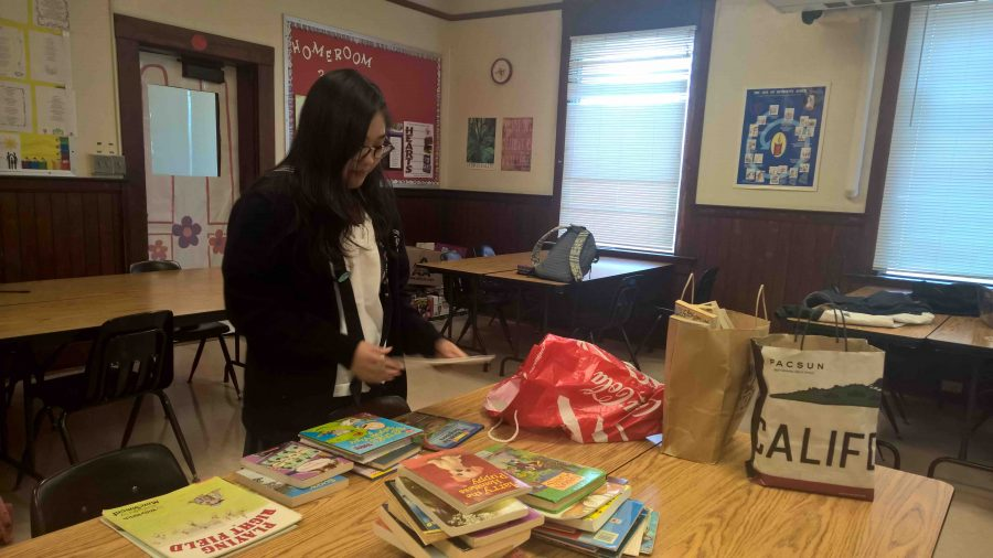Sophomore+division+member+Rin+Inuzuka+organizes+400+books+donated+by+the+sophomore+class%2C+as+part+of+their+service+project.