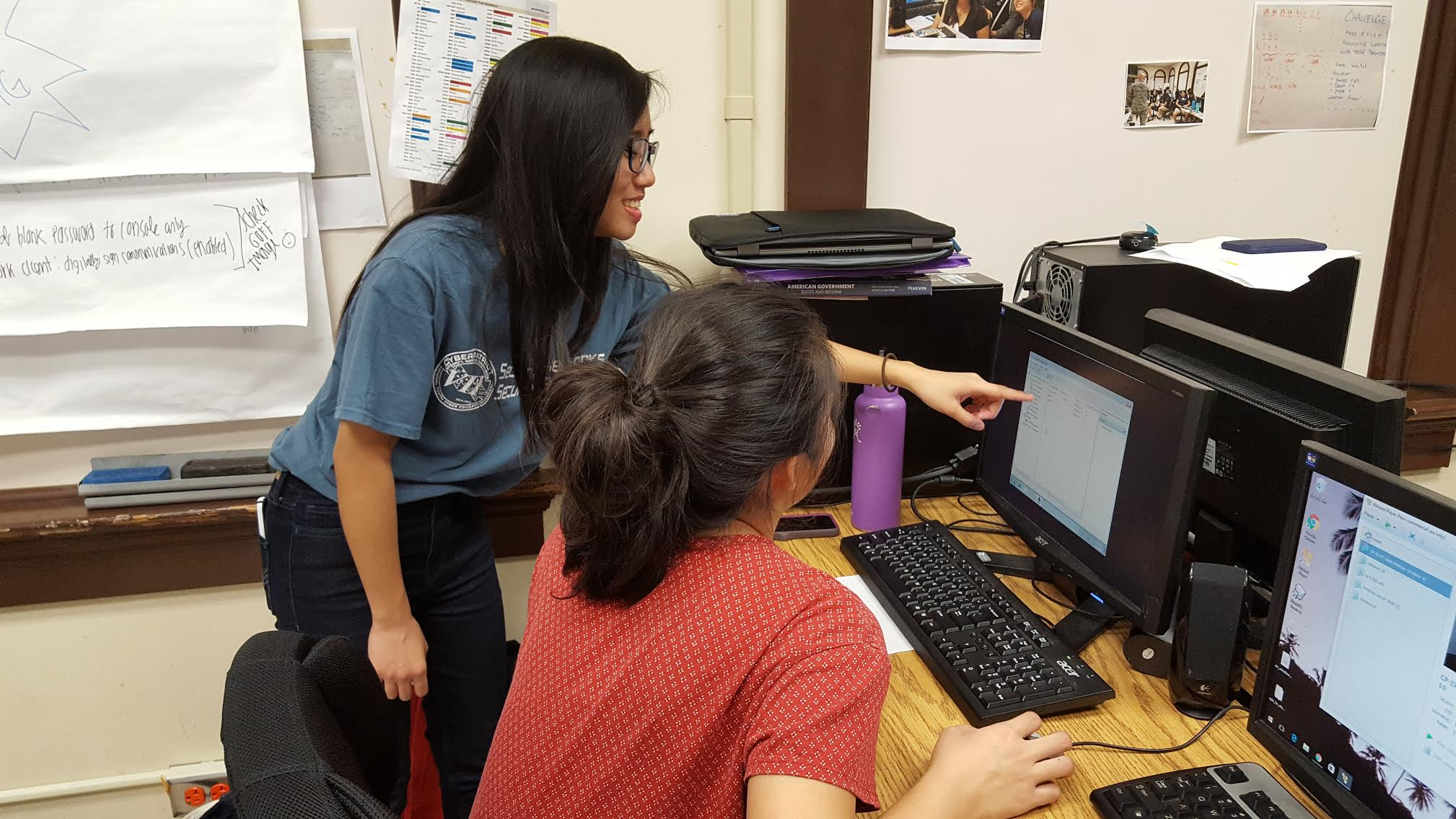 Tumacder helping senior Sydney Chock prepare for an upcoming cybersecurity competition.