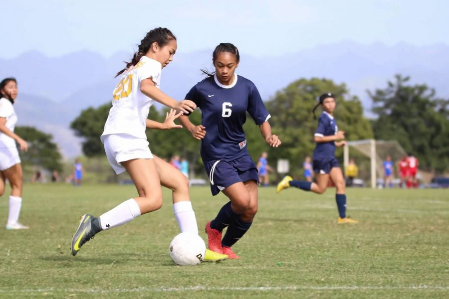 Academy+freshman+Alena+Schenk+keeps+the+ball+away+from+the+Waianae+defender+during+the+HHSAA+Division+II+state+tournament+earlier+this+month.++Photos+courtesy+of+Divino+Pazcoguin.+