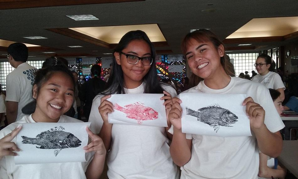 "(Left to right) Tyra Tabayoyong, Ragelle Lumapas and Rebecca Meyer with their finished ""gyotaku."""