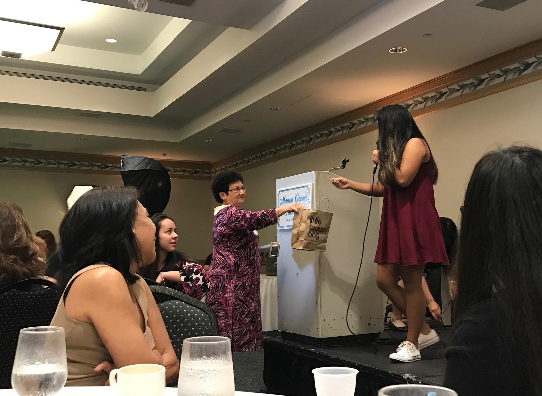 Freshman Leiolani Faurot about to begin her dance at this year's Mother Daughter Luncheon. Photo by Noe Nekotani.