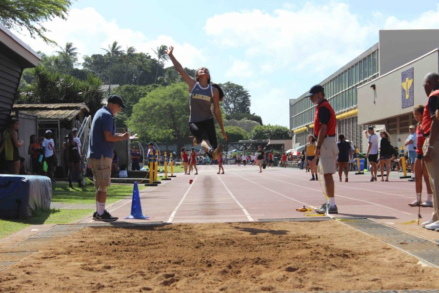 Chen+jumps+15+feet+and+four+inches%2C+placing+third+in+the+long+jump+event.