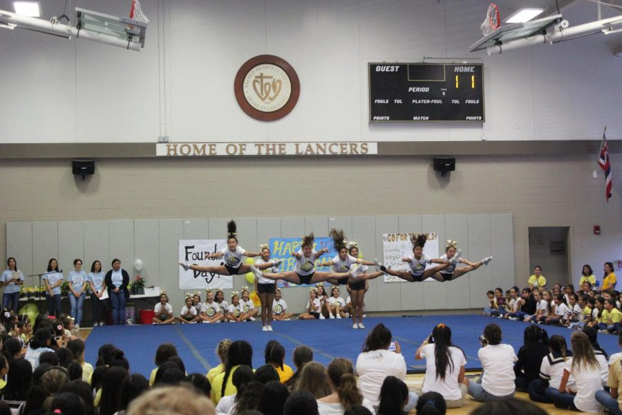 The+cheerleaders+brought+their+own+school+pride+to+the+assembly.+Photos+by+Shelby+Mattos.