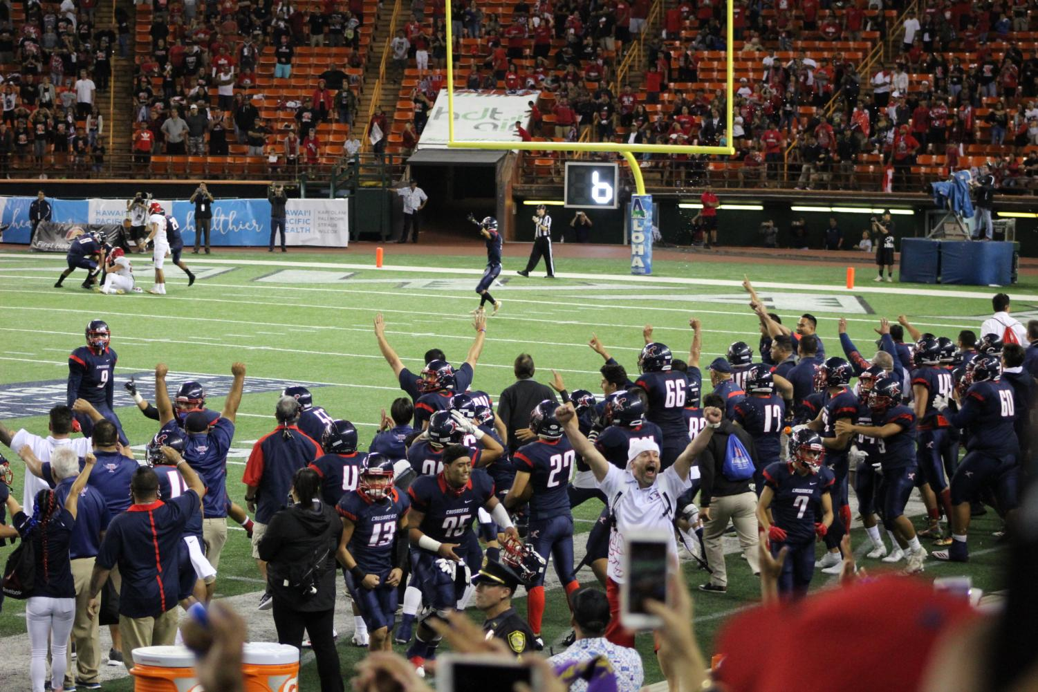 The Saint Louis Crusaders, along with fans, celebrate their victory over Kahuku. All photos courtesy of Melanie Constantino.