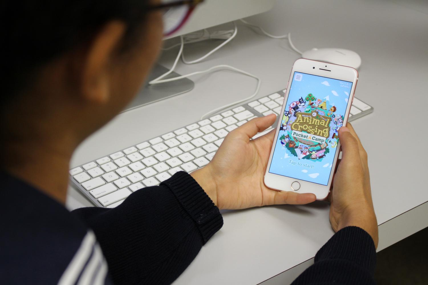 Junior Jasmine Matsumoto readies her Pocket Campers app. Photo by Noe Nekotani.