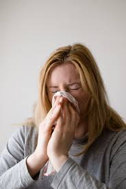 Sneezing is a symptom of many common sicknesses.  Photo courtesy of PxHere