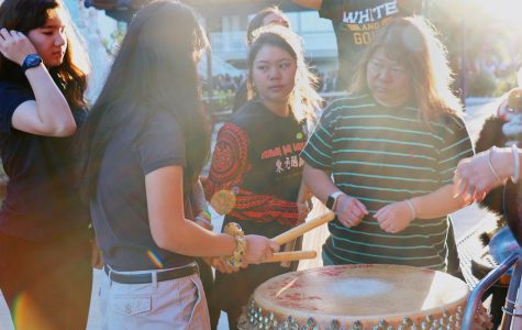 (Left to right) Eighth grader Vanessa Laub and freshmen Tammy Huynh and Clarisa Babauta prepare the drums with a club parent and mentor. According to Chinese mythology, the drumbeat represents the lion's heartbeat; without it, the lion ceases to exist. It also mimics the tale of how a village fought off the nian beast, known to take children if taxes were unpaid. Villagers made loud noises by banging pots and setting off firecrackers to scare away the monster.