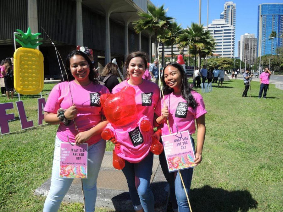(Left to right) Academy students Dilbul Floyd, Agnes Brown and Jessica Medrano advocated against flavored tobacco products with colorful signage and art at the Hawaii State Capitol. They are part of the Coalition for a Tobacco Free Hawaii (CTFH)'s youth council, which helped introduce bills proposing a ban on such products. Photo courtesy of Agnes Brown.
