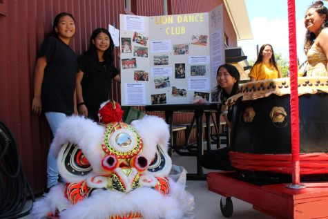 7th grader Darienne Inouye and Sophomores Zoe Chang and Kassandra Chang attract students to their Lion Dance club with the steady beat of their drum along with their vibrant lion dance costume. All photos by Noe Nekotani.
