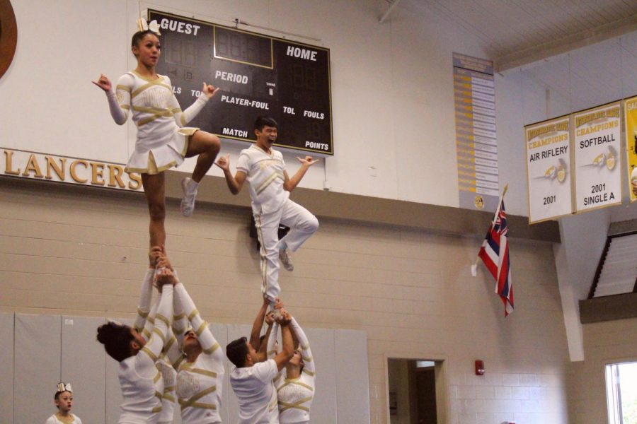 The Crusader and Lancer team show off their winning routine at a pep rally on the Academy campus last week. They won their second national title this year. All photos by Mercedes Anacleto.