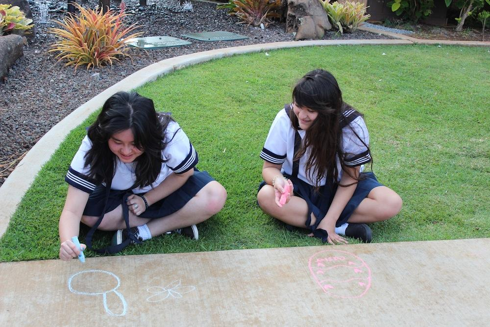 Seniors and sophomores, Big Sisters and Little Sisters, decorated the main walkway with images of Easter.