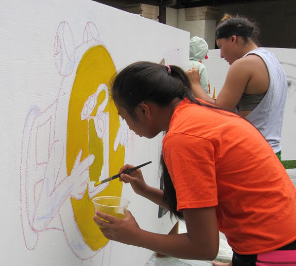 Sophomore Kaycee Selga and junior Jessica Hanashiro helped create a mural encouraging public awareness of Fire Prevention Week.