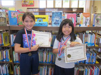 """Third graders Sabrina Kopf and Keira Iwamoto are two of 91 students who reached their reading goals every month this school year."""