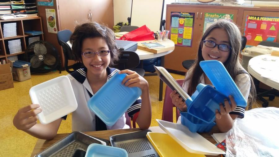 Lower+school+robotics+students+examine+the+disposal+of+styrofoam+trays+for+FLL+%22Trash+Trek%22+challenge.
