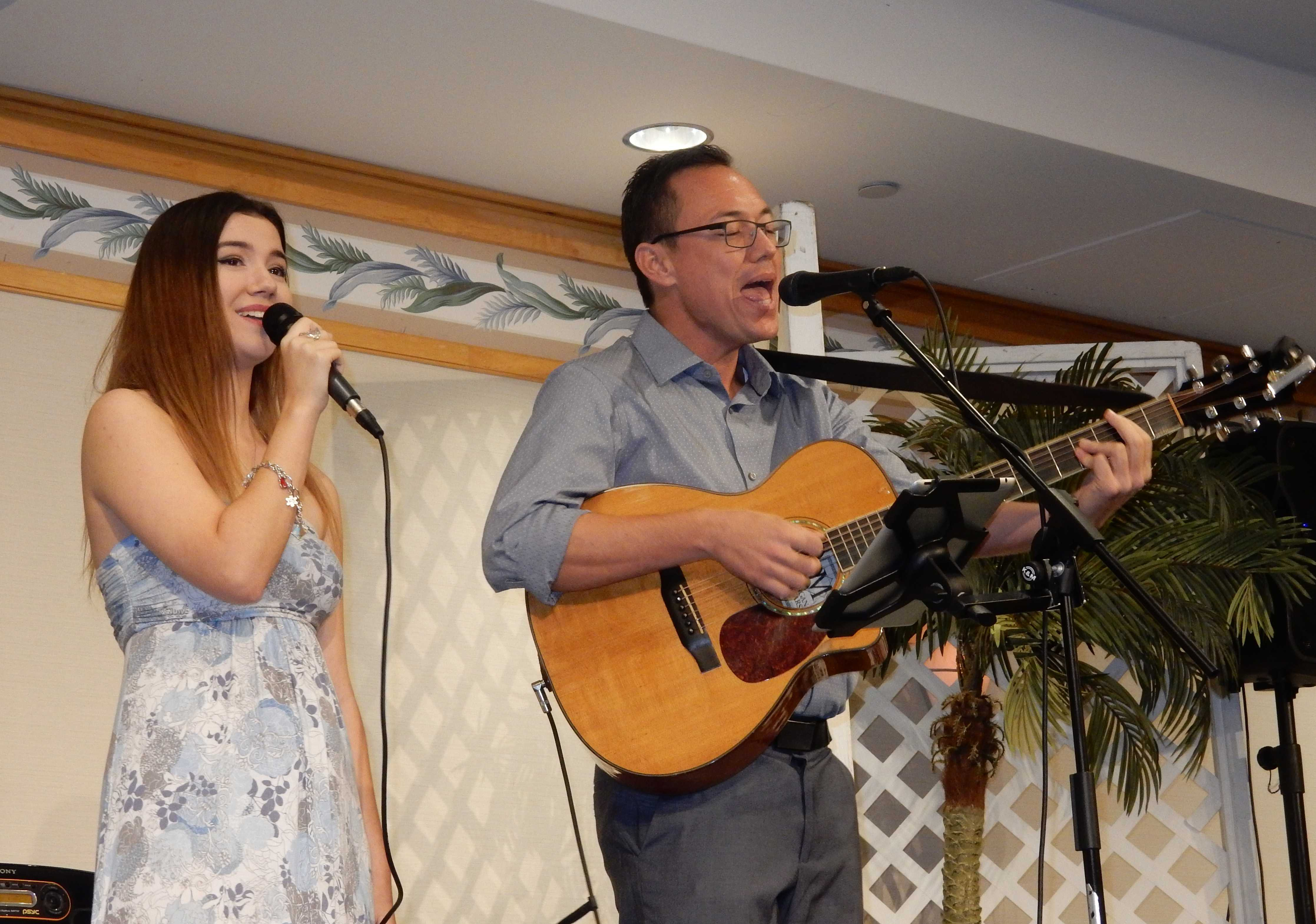 Senior Maya Waldrep performs with her father at the annual Senior Class Ohana Luncheon which celebrates parents and families who have supported students through the years. The occasion marks a last formal gathering of families and friends and classmates before graduation in May.  Photo courtesy of Janelle Medrano