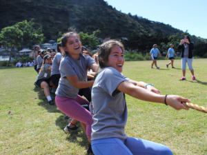 Seniors Lauren Remular and Alexandra Seto defend the honor of the Senior Class in the traditional tug-of-war contest against underclassmen. Students could choose from tug-of-war, kickball and water balloon competitions among other activities at Palolo park during the LIFE walk.