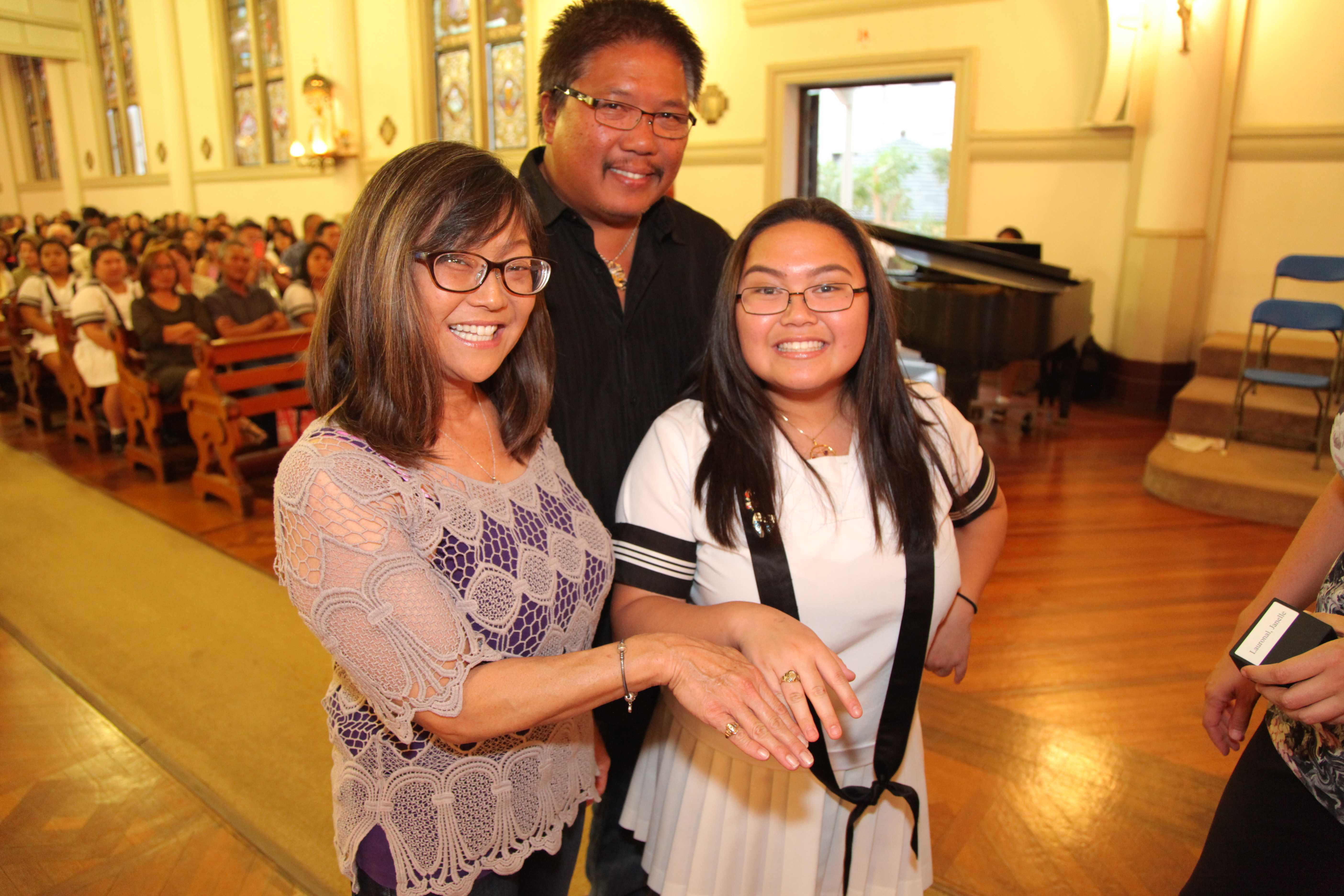 Junior Janelle Lauronal with her parents marks her permanent membership in the Academy ohana via the Junior Ring ceremony. The traditional event officially welcomed juniors as upperclassmen.  Photo Credit: Masa Yamaguchi