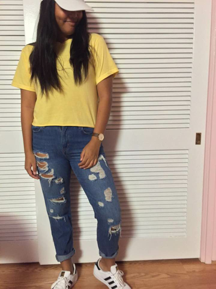"Academy sophomore Ragelle Lumapas is wearing a Brandy Melville crop top paired with Forever 21 ""mom jeans"" and white Adidas Superstar sneakers. This is one outfit combination popular this fall. Photo courtesy of Realesse Lumapas."