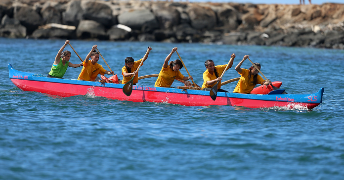 Kanalui Canoe Club races at Magic Island last year. The club is made up of students from Sacred Hearts Academy and Saint Louis School.