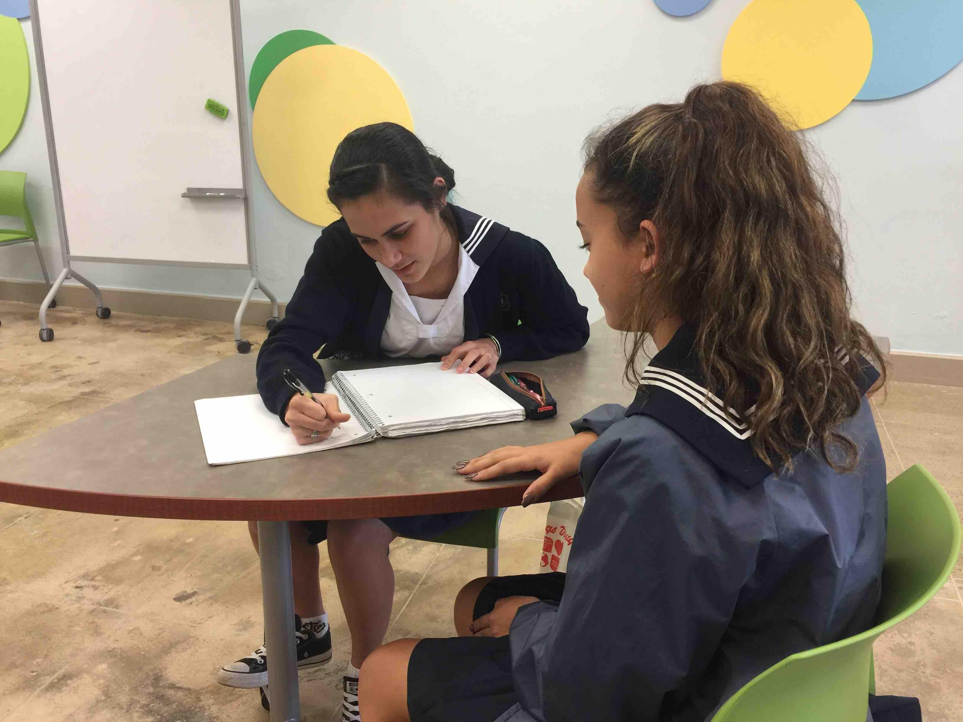 Senior Chloe Ponimoi works with freshman Hunter-Bailey Kaimikaua during after-school NHS tutoring.