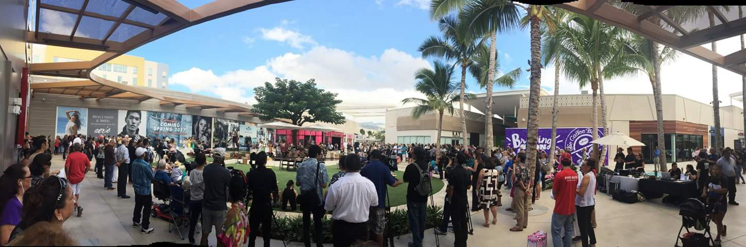 Shoppers watching a center stage performance during the grand opening of Ka Makana Alii shopping mall in Kapolei.