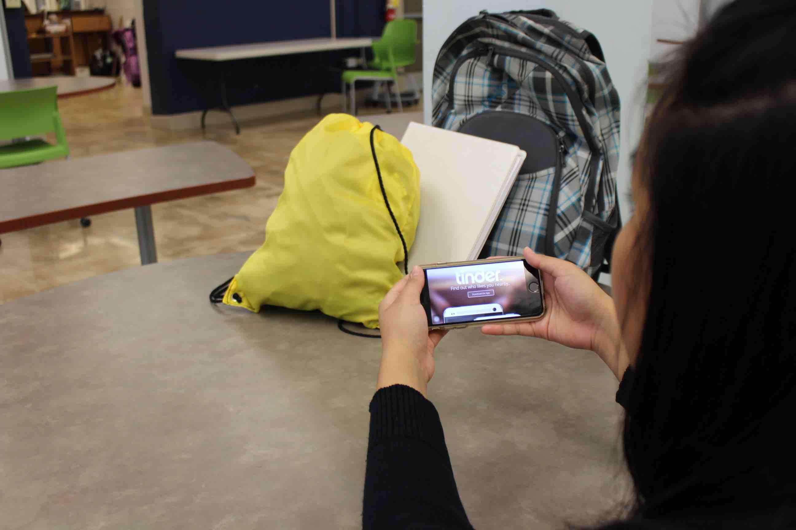 A teen accesses popular dating app Tinder on her mobile phone. She joins a rising number of today's youth, including those in Hawaii, who are dabbling in online danger, experts say. Photo by Ashley Marie Lardizabal.