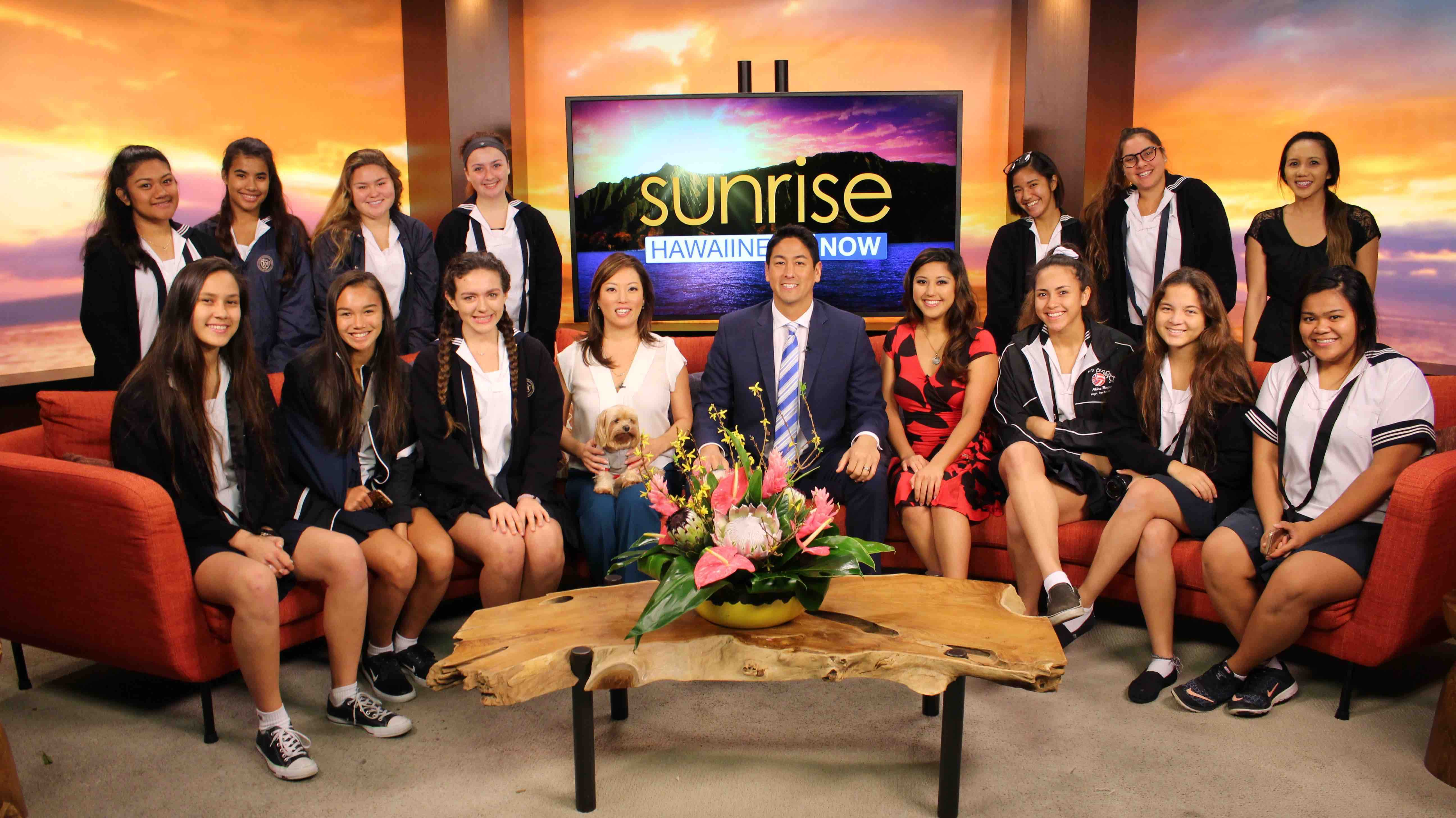 "The Video Productions/News Broadcast class on the set of Hawaii News Now's ""Sunrise"" show with anchors Grace Lee, Steve Uyehara and Lacy Deniz."