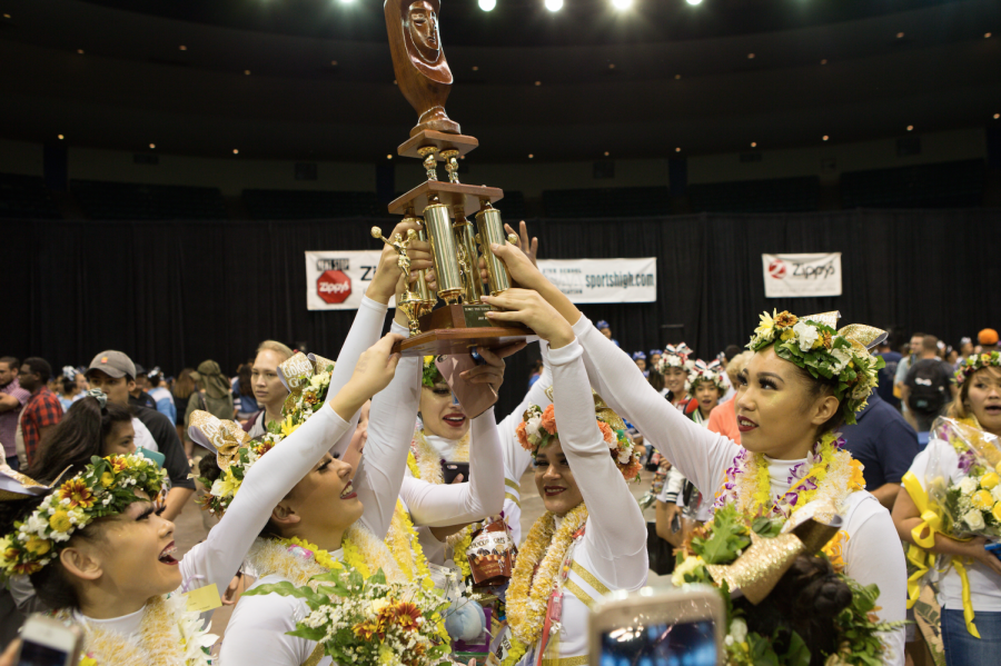 The+Academy%E2%80%99s+varsity+cheerleading+team%2C+also+known+as+the+Golden+Girls%2C+hold+their+trophy+after+winning+first+in+the+medium+division.+Photo+courtesy+of+808+Hot+Shots.+