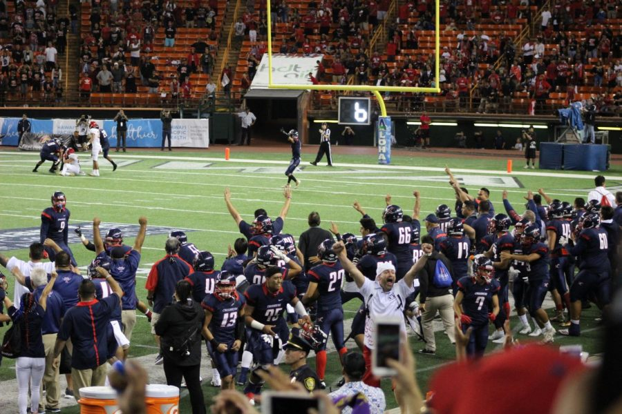 The+Saint+Louis+Crusaders%2C+along+with+fans%2C+celebrate+their+victory+over+Kahuku.+All+photos+courtesy+of+Melanie+Constantino.