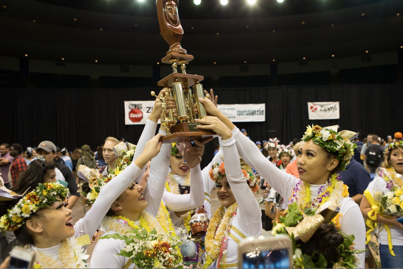 The Academy's varsity cheerleading team, also known as the Golden Girls, hold their trophy after placing first in the state championship medium division. Photos courtesy of 808 Hot Shots.