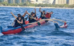 Sacred Hearts Academy's varsity team powers through its first 3-mile paddling race from Magic Island to Kewalo Basin earlier in the season. Steersman and senior Kauilani Murakami (back) is preparing to maneuver the canoe around the turn buoys. Photo by Rebecca Meyer.