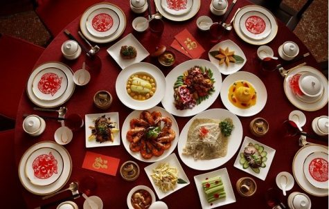 Some popular dishes in a Chinese New Year dinner include rice cakes, turnip cakes, dumplings and various seafood dishes. Photo courtesy of Weijiang.