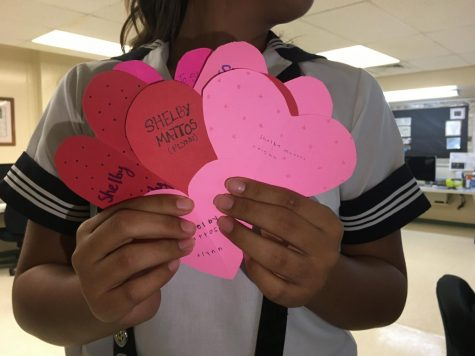 Students started their day with a sweet start when they received heart shaped notes and candies from their friends. Photo by Shelby Mattos.