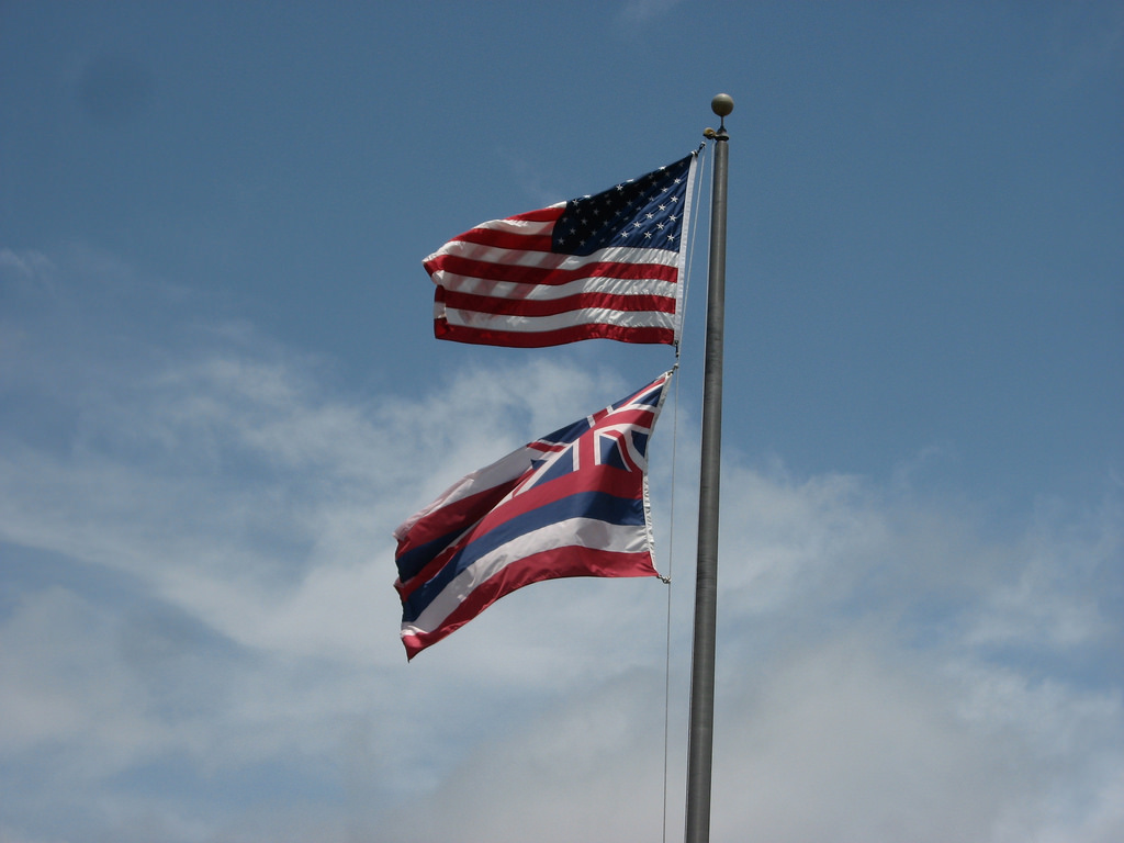 The law regarding how the Hawaiian flag should be flown underneath the National flag when on a single flagpole has been a debated topic for many years and protesters are looking for a change. Photo courtesy of Flickr.