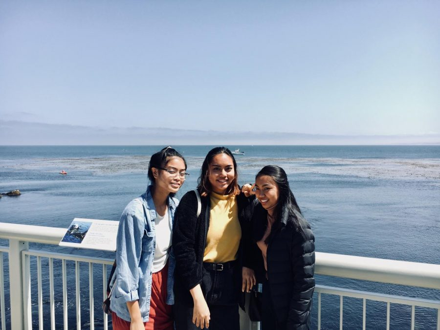 My+sister%2C+cousin+and+I+in+Monterey%2C+Calif.+Behind+us+was+the+blue+ocean+that+was+filled+with+a+variety+of+animals%2C+such+as+seals%2C+otters+and+plants.+Photo+courtesy+of+Ragelle+Lumapas.