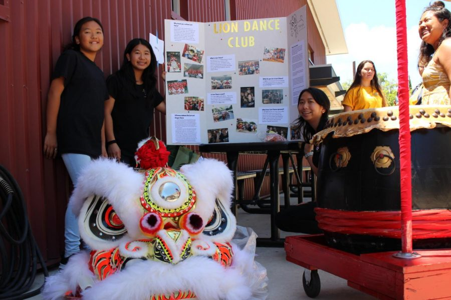 7th+grader+Darienne+Inouye+and+Sophomores+Zoe+Chang+and+Kassandra+Chang+attract+students+to+their+Lion+Dance+club+with+the+steady+beat+of+their+drum+along+with+their+vibrant+lion+dance+costume.+All+photos+by+Noe+Nekotani.%0A