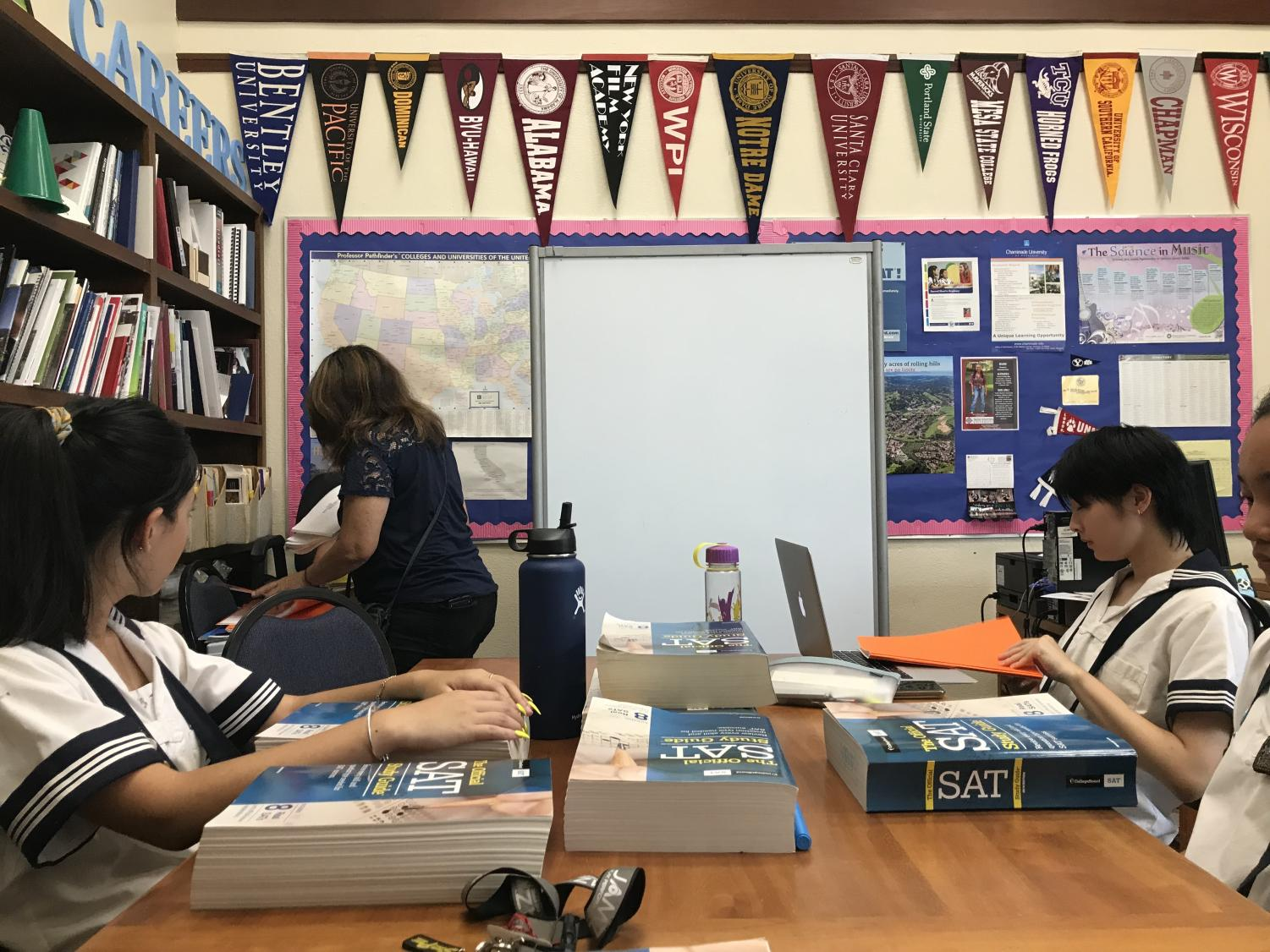 (Left to right) Junior Jasmine Lee  and senior Jiarong Wang get situated for their first day of SAT preparation classes. All photos by Noe Nekotani.