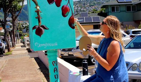 Artist Jenny Floro paints a mural on a traffic signal box in Kaimuki; it's one of 26 boxes that got makeovers as part of a project coordinated by Street Art Hawaii. Photo by Kirsten Aoyagi.