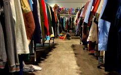 Clothing racks at Goodwill in Kaimuki offer a variety of secondhand items. The movement of shifting shopping habits to thrifting is a solution to the fast fashion industry, in which inexpensive clothing is rapidly produced and thus, resulting in an increase of waste. Photo by Ella blu Pakele.