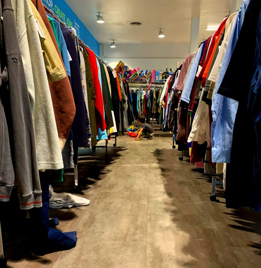 Clothing+racks+at+Goodwill+in+Kaimuki+offer+a+variety+of+secondhand+items.+The+movement+of+shifting+shopping+habits+to+thrifting+is+a+solution+to+the+fast+fashion+industry%2C+in+which+inexpensive+clothing+is+rapidly+produced+and+thus%2C+resulting+in+an+increase+of+waste.+Photo+by+Ella+blu+Pakele.